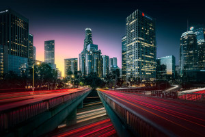 Downtown Los Angeles with its skyscrapers amd traffic lights at dawn